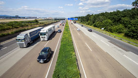 German cars on the autobahn. FRANKFURT, GERMANY - JULY 11, 2013: Traffic on a German highway. German autobahns have no general speedlimit and rank as the fifth royalty free stock images
