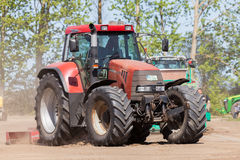 German case puma cvx 150 tractor drives on track Stock Photos