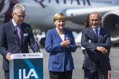 German Chancellor Angela Merkel (C) and Turkish Minister of transport Lutfi Elvan (R) open up the International aviation and space Stock Photography