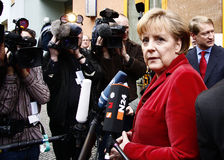 German Chancelor Angela Merkel. Talks to members of the press after a visit in a housing project for people with AIDS in Berlin-Kreuzberg, 26. Februar 2009 Royalty Free Stock Photo