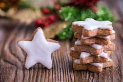 German Christmas cinnamon stars on a wooden table royalty free stock images