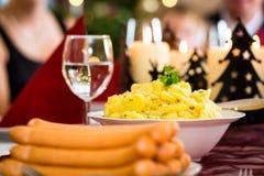 German Christmas dinner sausages and potato salad Stock Photos
