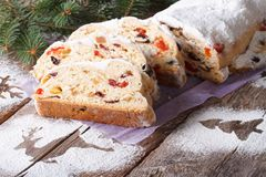 German Christmas fruit cake Stollen close-up on the table. Stock Image