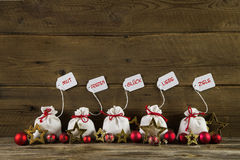German christmas greetings with presents and text on wooden back Stock Photography