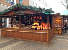 German Christmas market in Northampton, UK. A German Christmas market on the streets of Northampton, United Kingdom. Wooden huts selling German products at Xmas Royalty Free Stock Photos