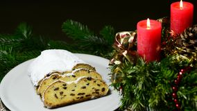 German Christmas stollen bakery with Advent wreath. On turn table stock video