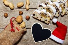 German christmas stollen, wooden background Stock Photo