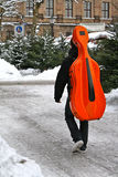 Man with red Cello in winter. Young man with his cello at german christmas-tree market Royalty Free Stock Photography