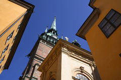 German Church in Gamla Stan Stockholm. Buildings in Gamla Stan, the old part of Stockholm, tower over the visitor. The German Church is prominent and its cross Royalty Free Stock Image