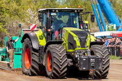 German claas axion tractor drives on track by a traktor pulling event Stock Photography