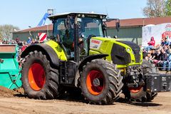 German claas axion tractor drives on track by a traktor pulling event Royalty Free Stock Photo