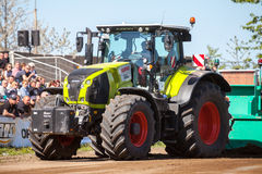 German claas axion tractor drives on track by a traktor pulling event Stock Photo