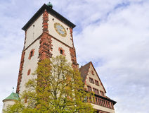 Clock tower in Germany. German clock tower under a cloudy sky Stock Photos
