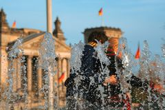 German colors. Young german couple close to the  'Deutscher Reichstag Royalty Free Stock Images