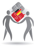 German Conversation. Two male silhouettes and Puzzle bubble talk with a German flag symbolizing German conversation.Vector illustration Stock Photos