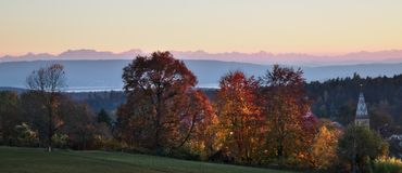 German countryside in autumn with the alps in the background stock image