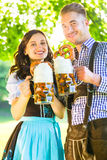 German couple in Tracht drinking beer Royalty Free Stock Photos