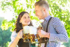 German couple in Tracht drinking beer Stock Image