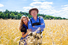 German couple in tracht on the field Stock Images