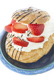 German Cream Puffs with strawberries in blue bowl Royalty Free Stock Images