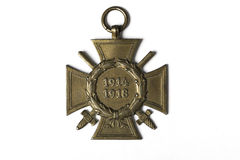 A German cross military medal from the first world war with ages 1914-1918 on white background isolated. With shadows Royalty Free Stock Image