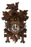 German Cuckoo Clock. Here is a picture of a wooden German Cuckoo clock isolated on white Royalty Free Stock Images