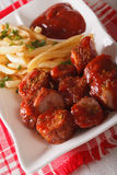 German cuisine: currywurst with french fries close-up. vertical Stock Photography