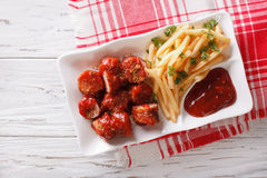 German cuisine: currywurst with french fries. Horizontal top vie Royalty Free Stock Images
