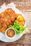 German cuisine - fried potato fritters Stock Photography
