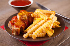 German curry sausage with french fries Royalty Free Stock Images