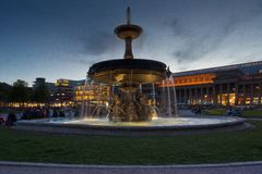 Water spout fountain at sunset stuttgart royalty free stock photography