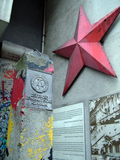 German Democratic Republic sign and red star, Column and Berlin wall portion near Checkpoint Charlie between east and west sectors. German Democratic Republic stock photo