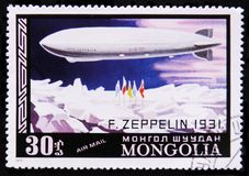 German dirigible Graf Zeppelin to the North Pole in 1931, circa 1977. MOSCOW, RUSSIA - APRIL 2, 2017: A post stamp printed in Mongolia shows German dirigible Royalty Free Stock Photos