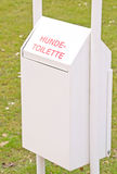 A German doggy bin. A German doggy rubbish toilet bin for dogs waste Royalty Free Stock Image