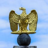 German Eagle golden emblem open wings stock photo