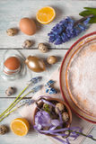 German Easter cake, eggs, flowers, ribbons on the table top view Royalty Free Stock Image