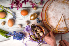 German Easter cake, a piece of cake, eggs, flowers, ribbons on a table Royalty Free Stock Images