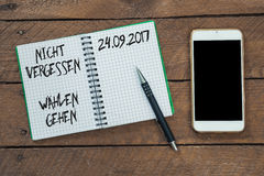 German election voting reminder on note pad. German election voting reminder `don`t forget, go vote` for federal elections in September 2017 on note pad with Stock Photography