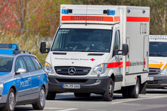 German emergency ambulance and police vehicle stands on the street Stock Photo