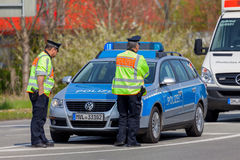German emergency ambulance and police vehicle stands on the street Royalty Free Stock Photography