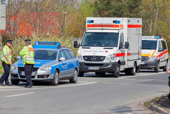 German emergency ambulance and police vehicle stands on the street Stock Images