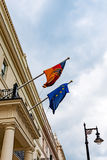 German and European Union flags waving from the German embassy balcony in London exterior view Royalty Free Stock Photos