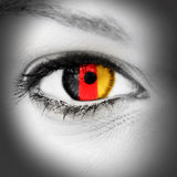 German eye. Eye of a pretty woman with german colors in the pupil Royalty Free Stock Images