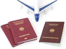 German family passports with plane isolated white background Stock Photo