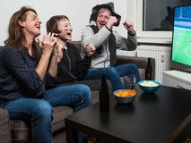 German family is watching football world cup soccer on tv royalty free stock photo