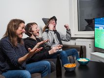 German family is watching football world cup soccer on tv stock photos