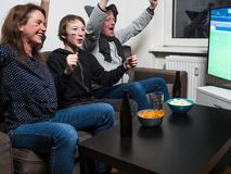 German family is watching football world cup soccer on tv royalty free stock images