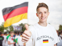 German fan showing thumb with other fans Royalty Free Stock Photos