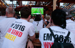 German Fans 027. Germany soccer team supporters spending their holidays at the spanish island of Mallorca meet on local bars to watch European cup match on giant stock photo