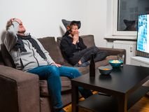 Father and son watching football world cup soccer on tv royalty free stock images